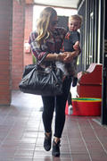 http://img238.imagevenue.com/loc359/th_027344476_Hilary_Duff_Babies_First_Class9_122_359lo.jpg